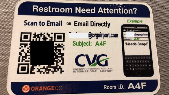 CVG posts placards showing how travelers can leave feedback on the state of the restrooms via OrangeQC. (Photo courtesy of CVG.)