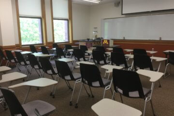 Neat rows of chairs in a clean classroom.